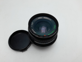 Objectif - Tokina RMC - 28 mm - L'Homme debout